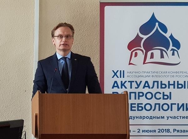 On the podium, Dr. Uldis Mauriņš (Latvia)
