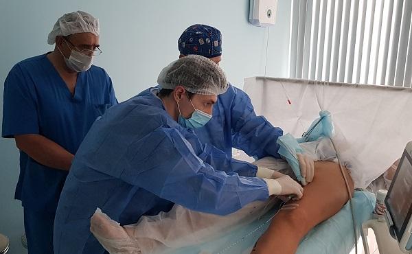 "Nikonov Petr Vladimirovich during a laser operation at the ""MIFC"""